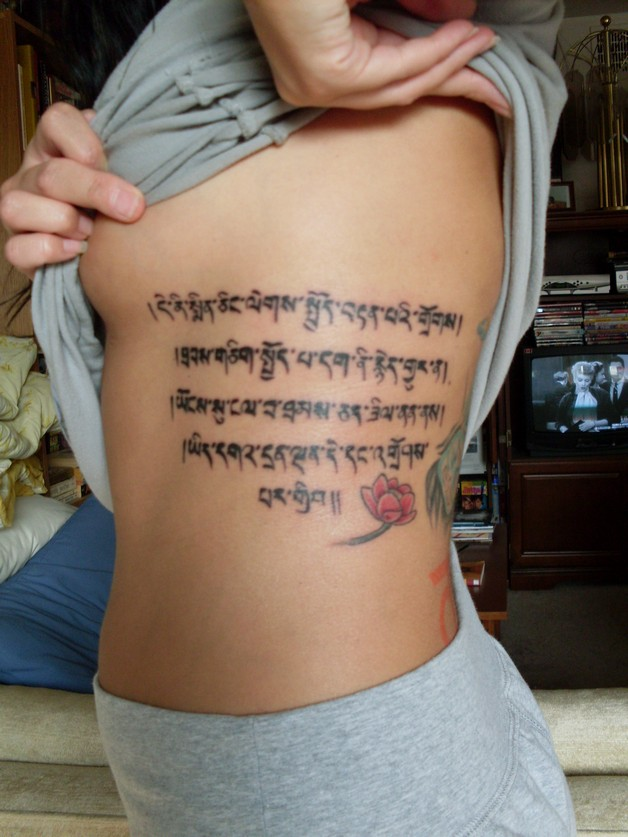 rib side buddhist tattoo photo - 2