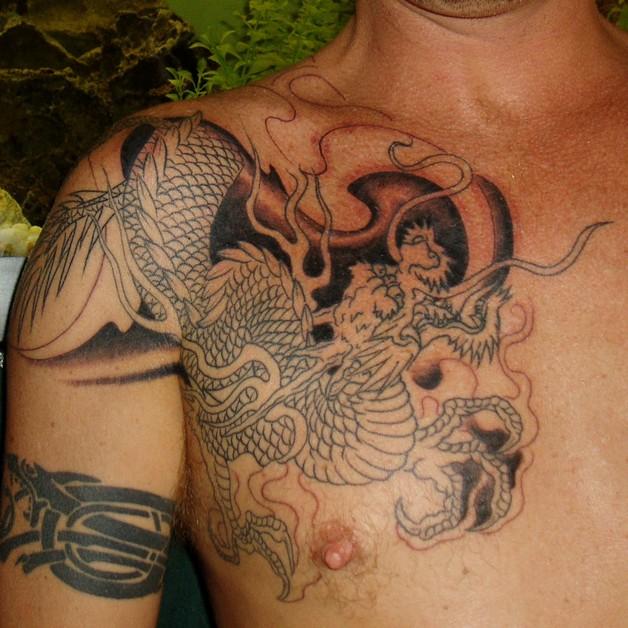 small bow feminine tattoo on biceps photo - 1