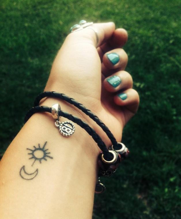 small camera with stars tattoo on wrist photo - 1