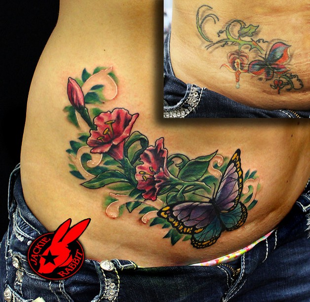 small flowers tattoos on stomach photo - 2