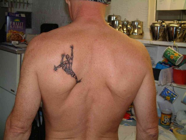 star tattoo on elbow for guys photo - 1