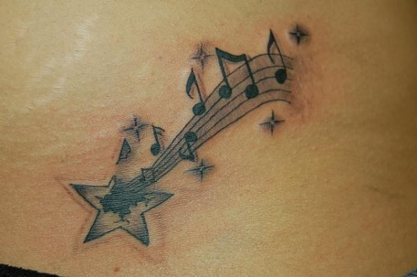 Stars falling from moon tattoo designs
