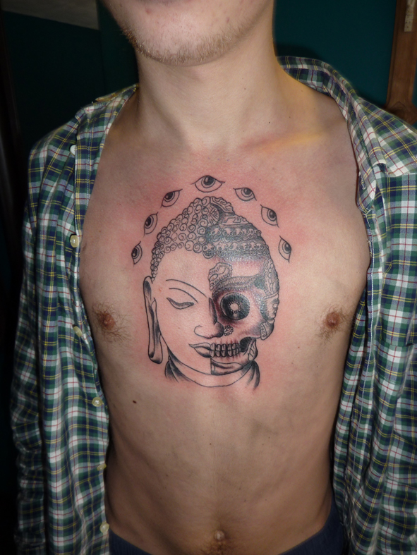 sugar skull buddhist tattoo on chest photo - 2