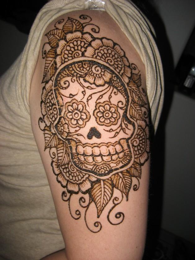 sugar skull flowers tattoo on biceps photo - 1
