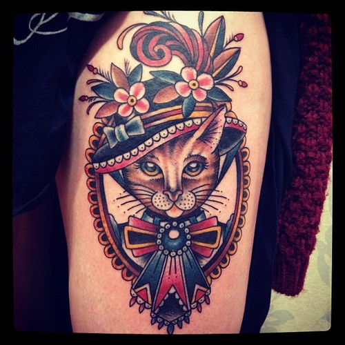 Traditional cat lady tattoo on biceps for Cat lady tattoo