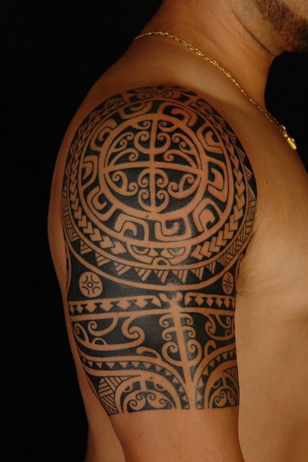 tribal butterfly feminine tattoo on back of shoulder photo - 1