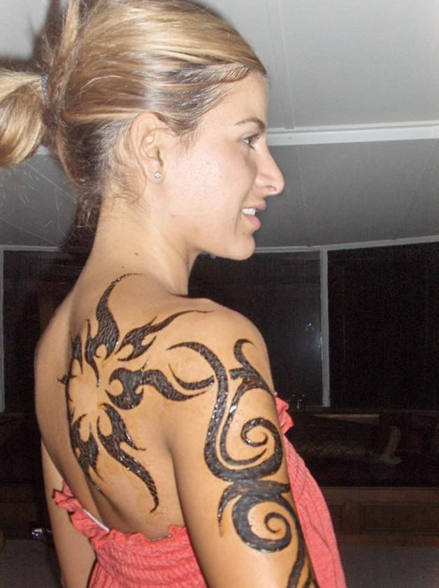 tribal flower feminine tattoo on shoulder photo - 1